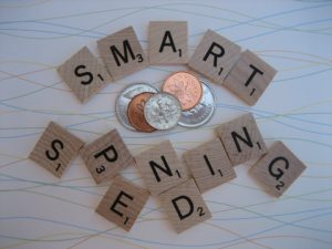 Scrabble tokens spelling out smart spending